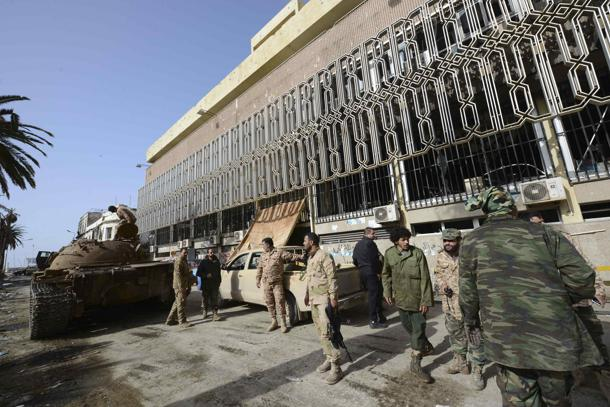 Members of the Libyan pro-government forces, backed by locals, gather next to the Central Bank, near Benghazi port