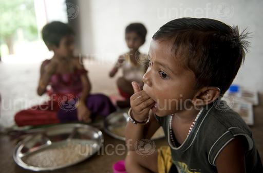 Sanjana Lodha eats her mid day meal at the Anganwadi centre in village Hilgna, district Guna in Madhya Pradesh.Despite being rich in natural resources like diamonds, Madhya Pradesh is more infamous for its poverty. It is home to around 50 million people who defecate in the open air without latrines (around 70% of its 72 million people). These people consequently do not have adequate hygiene, without soap and enough water to wash their hands after defecating. About 5% of the global total of open defecators can be found in this one Indian state alone. Madhya Pradesh is also home to some of the most undernourished children in India with 50% of under threeÕs suffering from stunting (chronic malnutrition), an indicator of long-term persistent nutrition deprivation that lead to poor physical growth and brain development in children with tragic implications for child survival, growth and development. As much as 50% of malnutrition is caused not by a lack of food or poor diets, but due to poor water, poor sanitation facilities and unhygienic practices - like not washing hands properly with soap.  2.5 billion cases of diarrhoea in children under-five are recorded worldwide every year , and in India diarrhoea caused 2,12,000 child deaths in 2010 alone. Moreover, many people do not recognise diarrhoea as a problem; because it is so recurrent it is thought to be normal, and they do not seek help. These numbers are therefore likely to be under reported.  UNICEF India/ 2013/ Manpreet Romana